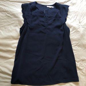 Blue scalloped sleeveless blouse